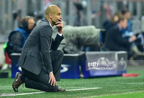 TOPSHOT Bayern Munich's Spanish head coach Pep Guardiola follows the action during the UEFA Champions League semifinal secondleg football match...