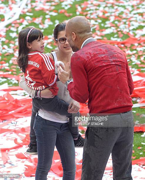 Bayern Munich's Spanish head coach Pep Guardiola speaks with his daughters Maria and Valentina after the German first division Bundesliga football...