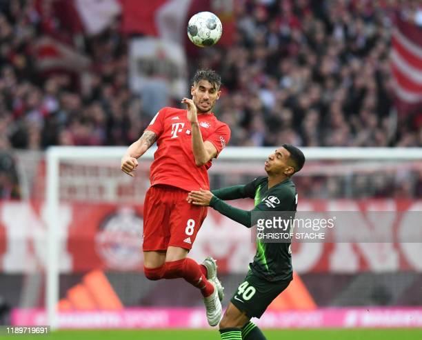 Bayern Munich's Spanish midfielder Javi Martinez and Wolfsburg's Brazil midfielder Joao Victor vie for the ball during the German first division...