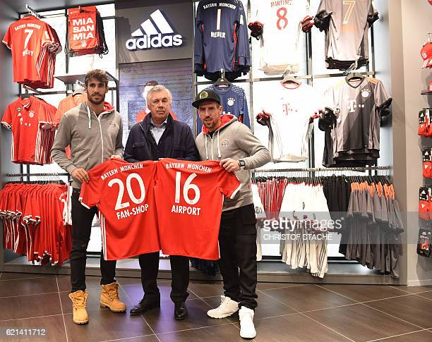 Bayern Munich's Spanish midfielder Javi Martinez Bayern Munich's French midfielder Franck Ribery and Bayern Munich's Italian headcoach Carlo...