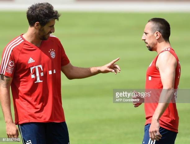 Bayern Munich's Spanish midfielder Javier Martinez and Bayern Munich's French midfielder Franck Ribery gesture as they attend a training session of...