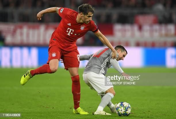 Bayern Munich's Spanish midfielder Javier Martinez and Olympiakos' Portuguese midfielder Daniel Podence vie for the ball during the UEFA Champions...