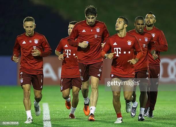 Bayern Munich's Spanish midfielder Javier Martinez Brazilian defender Rafinha Chilean midfielder Arturo Vidal Spanish midfielder Thiago Alcantara and...
