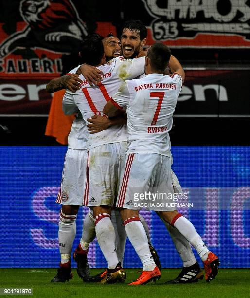 Bayern Munich's Spanish midfielder Javier Martinez celebrates scoring the opening goal with his teamates during the German First division Bundesliga...