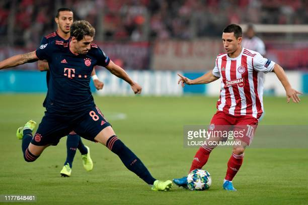 Bayern Munich's Spanish midfielder Javier Martinez fights for the ball with Olympiakos' Portuguese midfielder Daniel Podence during the UEFA...