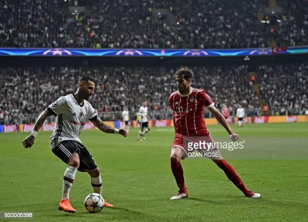 Bayern Munich's Spanish midfielder Javier Martinez fights for the ball with Besiktas midfielder Ricardo Quaresma during the second leg of the last 16...