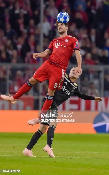 Bayern Munich's Spanish midfielder Javier Martinez heads the ball during the UEFA Champions League Group E football match between Bayern Munich and...