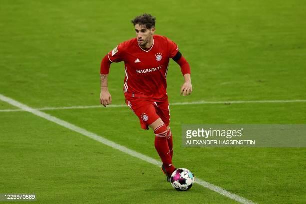 Bayern Munich's Spanish midfielder Javier Martinez runs with the ball during the German first division Bundesliga football match FC Bayern Munich v...