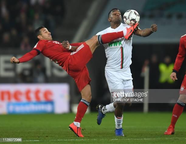 Bayern Munich's Spanish midfielder Thiago Alcantara and Augsburg's Venezuelan midfielder Sergio Cordova vie for the ball during the German first...