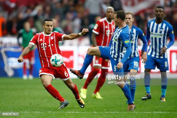 Bayern Munich's Spanish midfielder Thiago Alcantara and Berlin's Czech midfielder Vladimir Darida vie for the ball during the German first division...