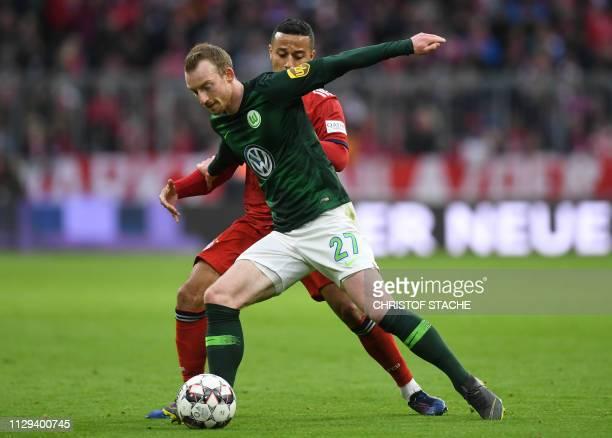 Bayern Munich's Spanish midfielder Thiago Alcantara and Wolfsburg's midfielder Maximilian Arnold vie for the ball during the German first division...