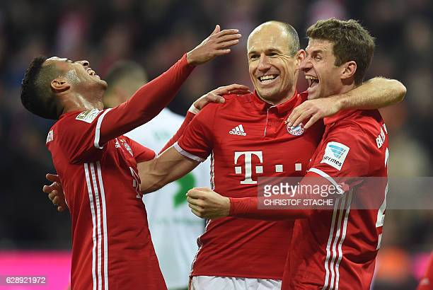 Bayern Munich's Spanish midfielder Thiago Alcantara Bayern Munich's Dutch midfielder Arjen Robben and Bayern Munich's striker Thomas Mueller...