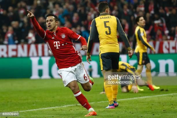 Bayern Munich's Spanish midfielder Thiago Alcantara celebrate scoring the 41 goal with Bayern Munich's Polish forward Robert Lewandowski during the...
