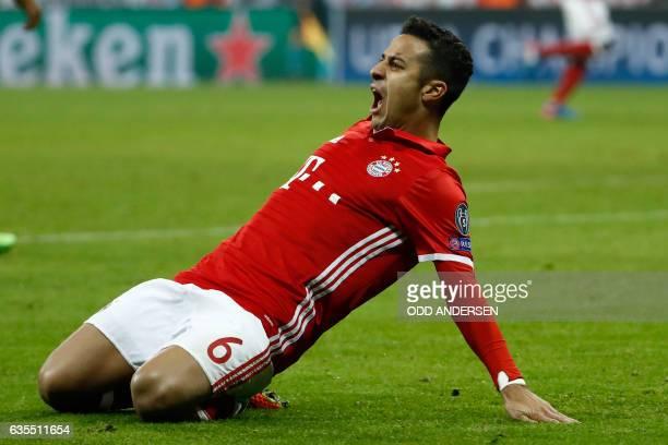 Bayern Munich's Spanish midfielder Thiago Alcantara celebrate scoring during the UEFA Champions League round of sixteen football match between FC...