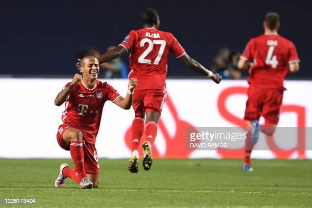 Bayern Munich's Spanish midfielder Thiago Alcantara celebrates after Bayern opened the scoring during the UEFA Champions League final football match...