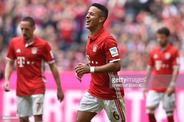 Bayern Munich's Spanish midfielder Thiago Alcantara celebrates after scoring the 40 during the German first division Bundesliga football match...