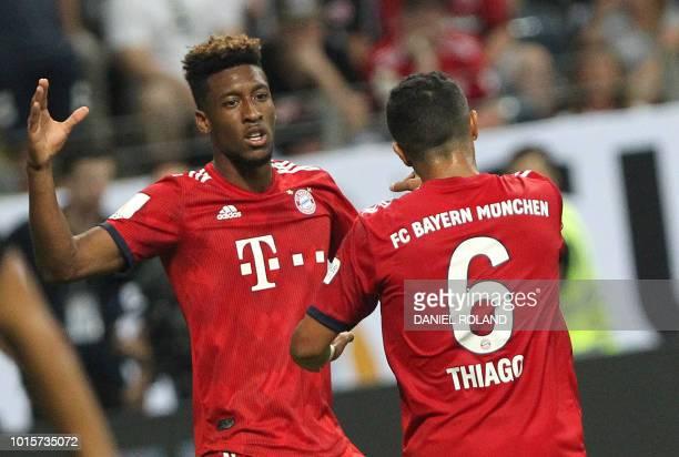Bayern Munich's Spanish midfielder Thiago Alcantara celebrates scoring his side 5th goal on the night with team mate Bayern Munich's French forward...