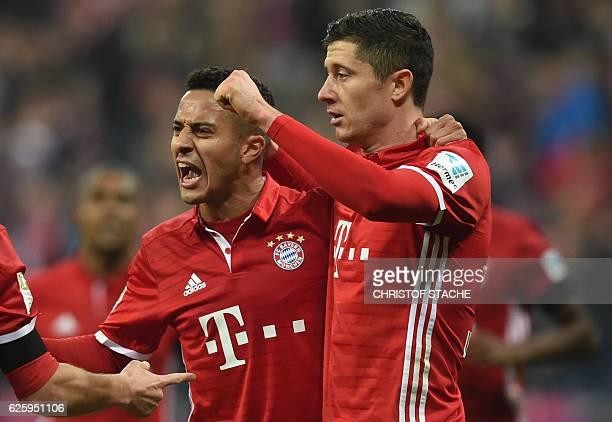 Bayern Munich's Spanish midfielder Thiago Alcantara celebrates scoring the opening goal with his teammate Polish striker Robert Lewandowski during...