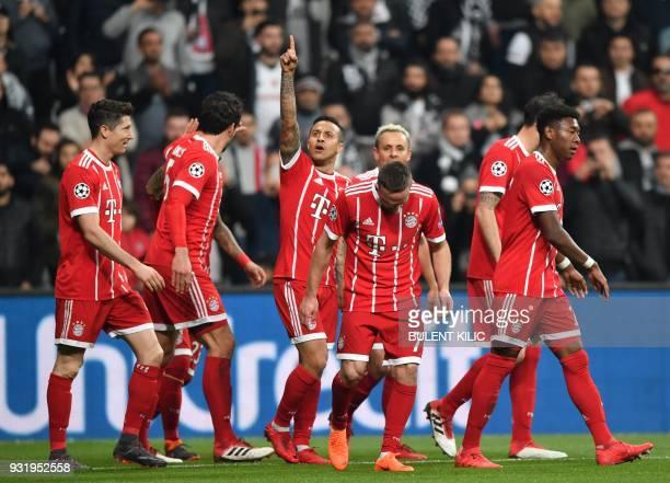 Bayern Munich's Spanish midfielder Thiago Alcantara celebrates scoring his team's first goal during the second leg of the last 16 UEFA Champions...