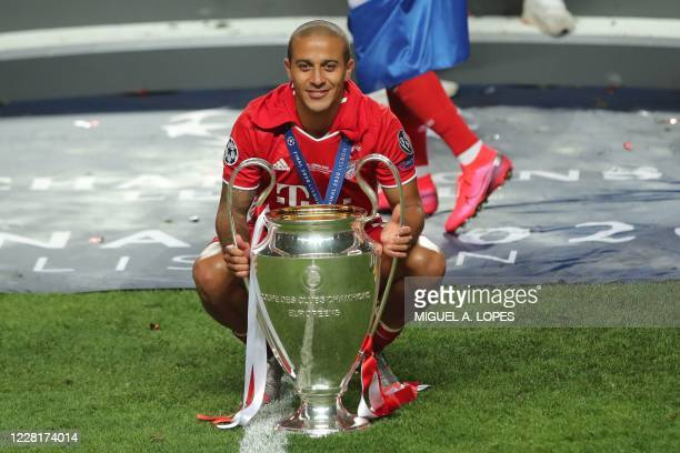 Bayern Munich's Spanish midfielder Thiago Alcantara celebrates with the trophy after the UEFA Champions League final football match between Paris...