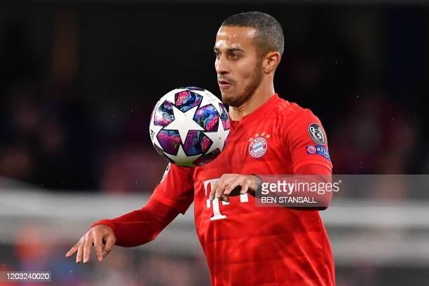 Bayern Munich's Spanish midfielder Thiago Alcantara controls the ball during the UEFA Champion's League round of 16 first leg football match between...