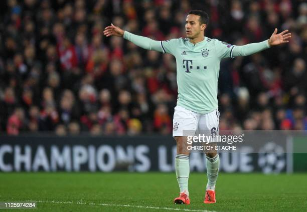 Bayern Munich's Spanish midfielder Thiago Alcantara gestures during the UEFA Champions League round of 16 first leg football match between Liverpool...