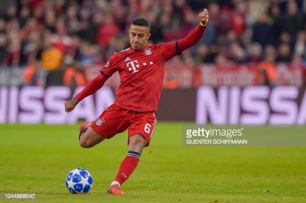 Bayern Munich's Spanish midfielder Thiago Alcantara kicks the ball during the UEFA Champions League Group E football match between Bayern Munich and...