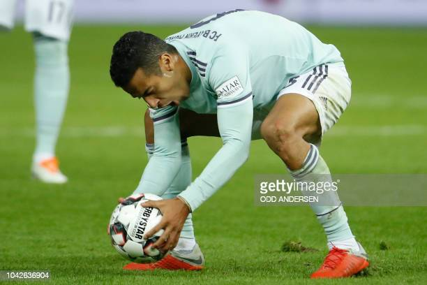 Bayern Munich's Spanish midfielder Thiago Alcantara reacts in frustrartion after a decision went against them during the German first division...