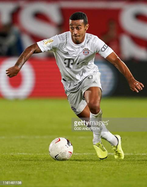 Bayern Munich's Spanish midfielder Thiago Alcantara runs with the ball during the German Cup first round football match FC Energie Cottbus v FC...