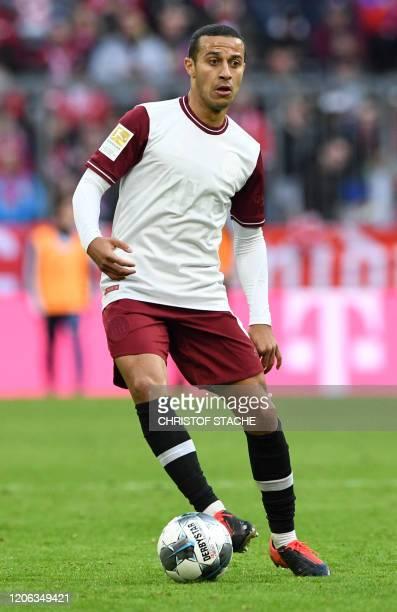 Bayern Munich's Spanish midfielder Thiago Alcantara runs with the ball during the German first division Bundesliga football match FC Bayern Munich v...