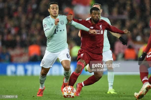 Bayern Munich's Spanish midfielder Thiago Alcantara vies with Liverpool's Dutch midfielder Georginio Wijnaldum during the UEFA Champions League round...
