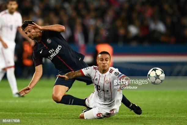 Bayern Munich's Spanish midfielder Thiago Alcantara vies with Paris SaintGermain's Italian midfielder Thiago Motta during the UEFA Champions League...
