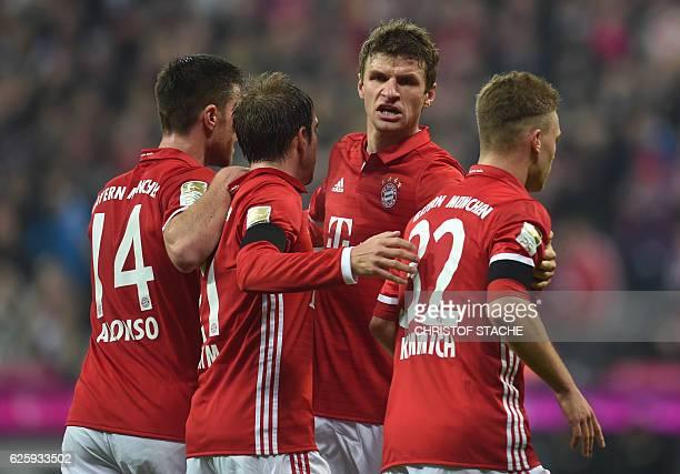 Bayern Munich's Spanish midfielder Xabi Alonso Bayern Munich's defender Philipp Lahm Bayern Munich's striker Thomas Mueller and Bayern Munich's...