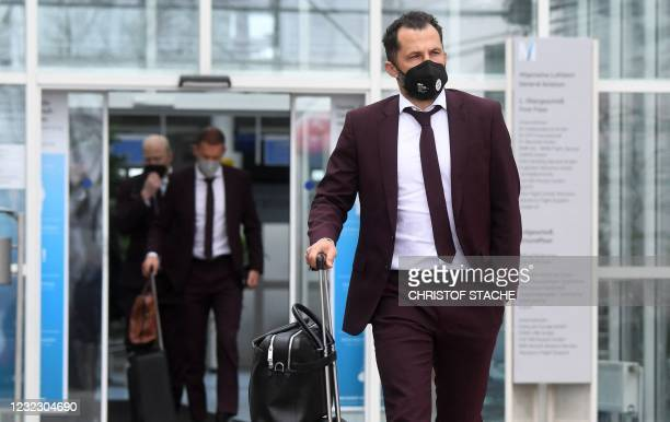 Bayern Munich's Sporting Director Hasan Salihamidzic leaves the airport upon arrival in Munich, southern Germany, on April 14, 2021 as the FC Bayern...