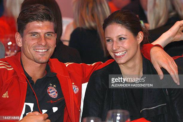 Bayern Munich's striker Mario Gomez and his partner Silvia Meichel attend an event of Bayern Munich in Berlin on May 13 2012 The event takes place...