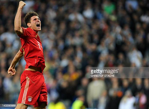 Bayern Munich's striker Mario Gomez celebrates after winning the UEFA Champions League second leg semifinal football match Real Madrid against Bayern...
