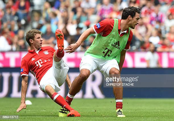 Bayern Munich's striker Thomas Mueller and Bayern Munich's new defender Mats Hummels vie for the ball during a training session of the German first...