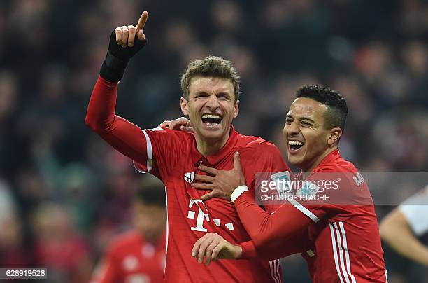 Bayern Munich's striker Thomas Mueller and Bayern Munich's Spanish midfielder Thiago Alcantara celebrate after the third goal for Munich during the...