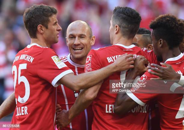 Bayern Munich's striker Thomas Mueller Bayern Munich's Dutch midfielder Arjen Robben Bayern Munich's Polish striker Robert Lewandowski and Bayern...