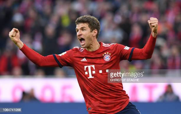 Bayern Munich's striker Thomas Mueller celebrates after his goal for Munich during the German first division Bundesliga football match between FC...