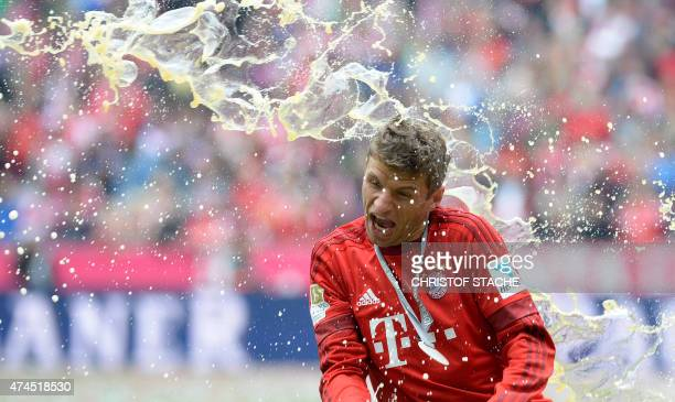 Bayern Munich's striker Thomas Mueller gets a beer shower as the club celebrates winning their 25th Bundesliga title after the German first division...
