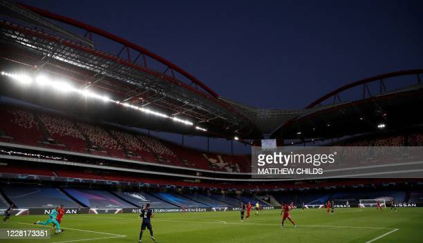 Bayern Munich's team players and Paris Saint-Germain's team players fight for the ball during the UEFA Champions League final football match between...