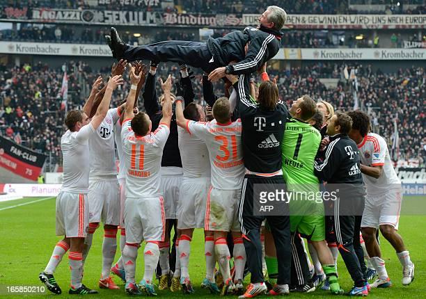 Bayern Munich's team players lift their headcoach Jupp Heynckes in the air after winning the German first division Bundesliga football match...