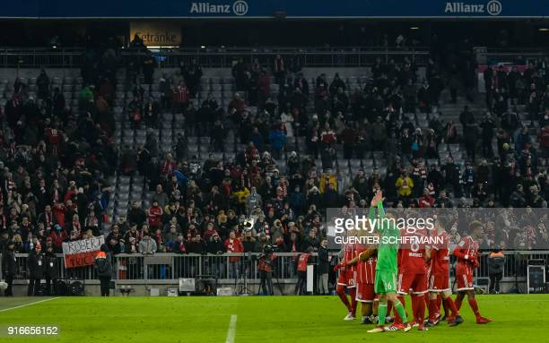 Bayern Munich's team players wave to the the supporters after they won the German first division Bundesliga football match FC Bayern Munich vs...