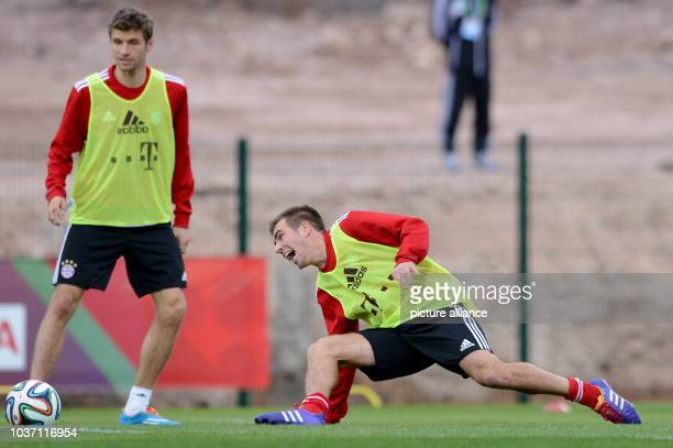 FCBayern Munich's Thomas Mueller and Philipp Lahm take part in a training session at the stadium'Stade Adrar' in Agadir Morocco 20December 2013...