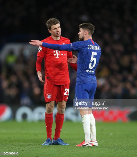 Bayern Munich's Thomas Muller and Chelsea's Jorginho exchange words during the UEFA Champions League round of 16 first leg match between Chelsea FC...