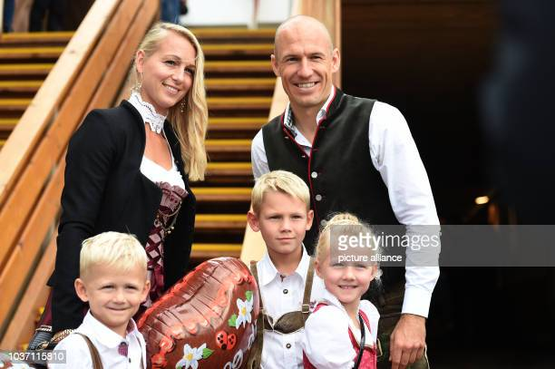 FC Bayern player Arjen Robben his wife Bernadien and their children leave the Kaefer festival tent after the FCBayern Oktoberfest at Oktoberfest in...