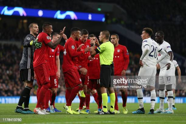 Bayern players argue with referee Clement Turpin during the UEFA Champions League group B match between Tottenham Hotspur and Bayern Muenchen at...