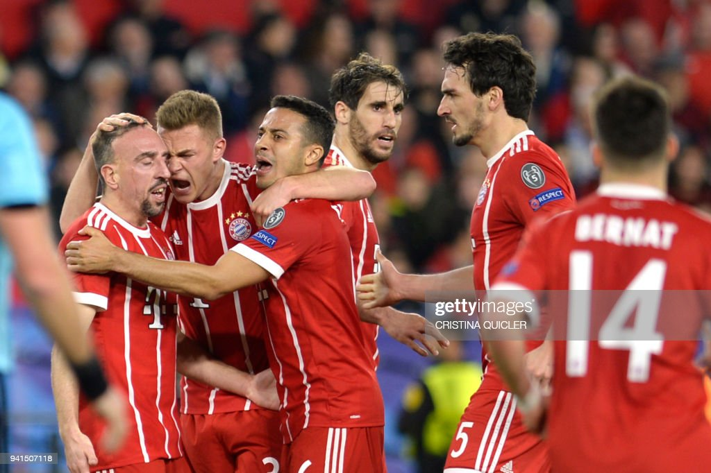 Bayern players celebrate Sevilla's Spanish midfielder Jesus Navas' own goal during the UEFA Champions League quarter-final first leg football match between Sevilla FC and Bayern Munich at the Ramon Sanchez Pizjuan Stadium in Sevilla on April 3, 2018. /