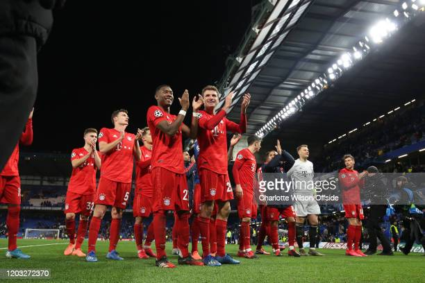 Bayern players celebrate their 3-0 victory during the UEFA Champions League round of 16 first leg match between Chelsea FC and FC Bayern Muenchen at...